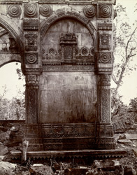 Close view of blind arch on ruined tomb, Champaner, showing carved stonework